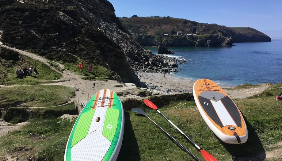 paddle boarding at Trevellis Porth - moving to cornwall