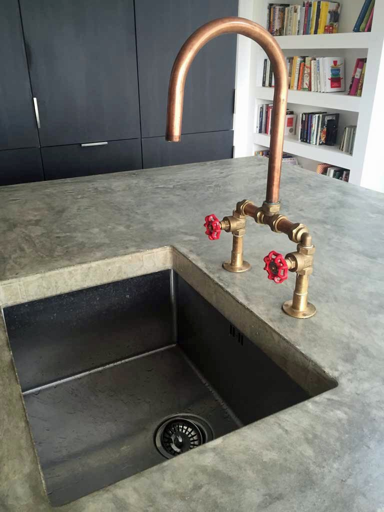 Industrial style concrete sink and copper taps