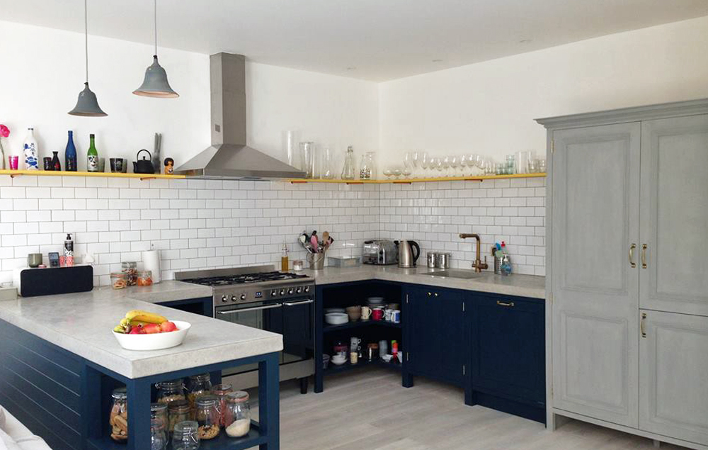 Arnold's kitchens, kitchen design featuring concrete worktops, navy cupboards and brick tiles