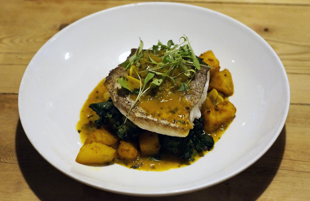 Halsetown Inn, St Ives, food - Grilled hake fillet, tamarind, coriander and fenugreek sauce, turmeric roast potatoes and kale sprouts