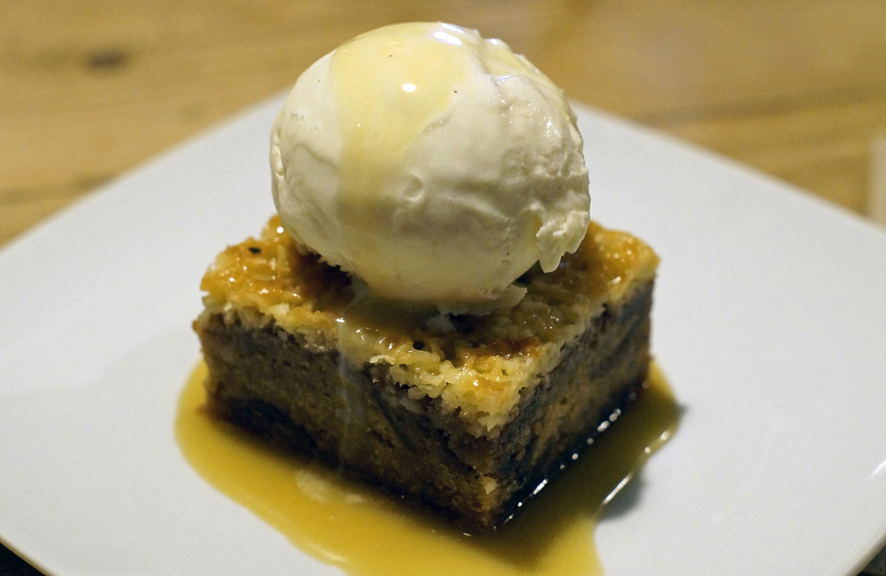 Halsetown Inn Pudding - Sticky fig pudding, salted caramel and coconut topping, vanilla ice cream and toffee sauce