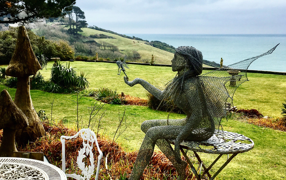 Wire fairy sculpture at Talland Bay Hotel Cornwall