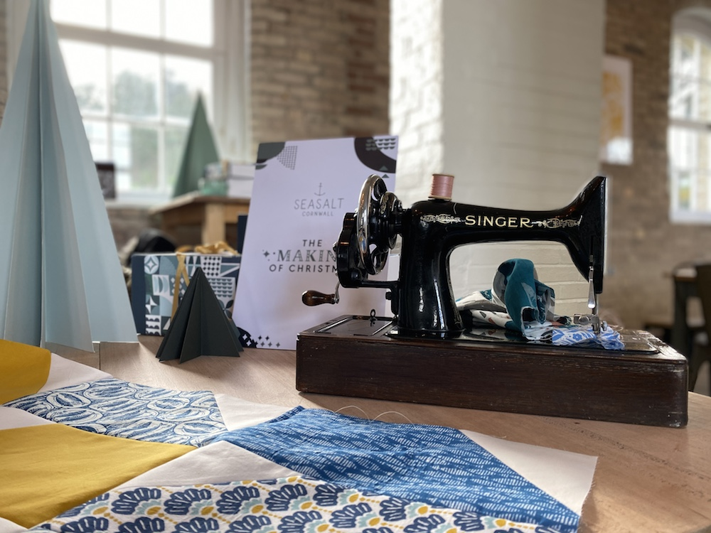 quilt blocks made of remnants beside a vintage sewing machine