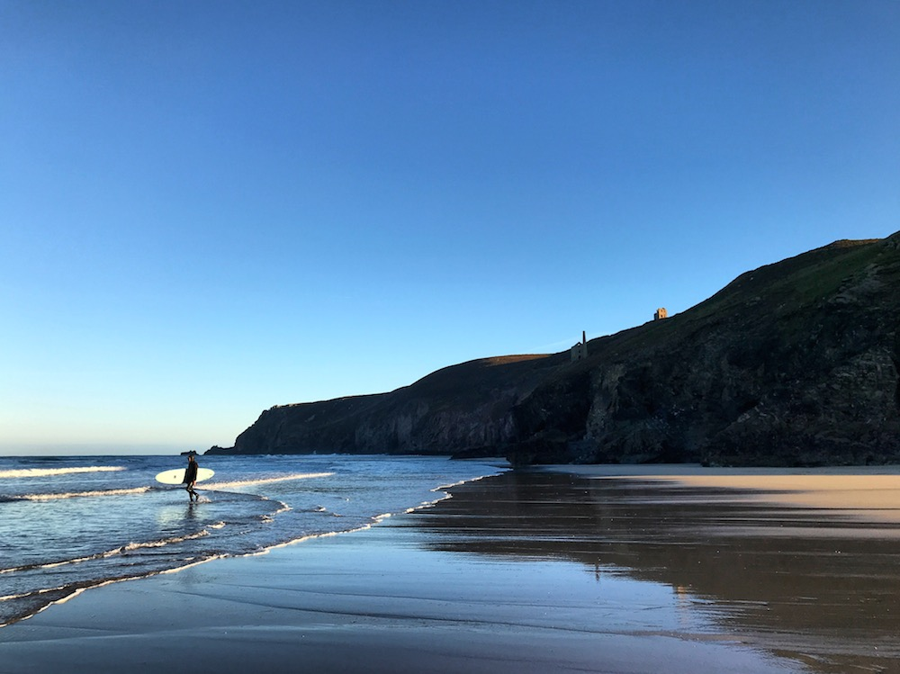 chapelporth beach with surfer